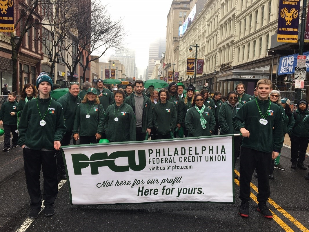 PFCU employees marched along the St. Patrick's Day Parade